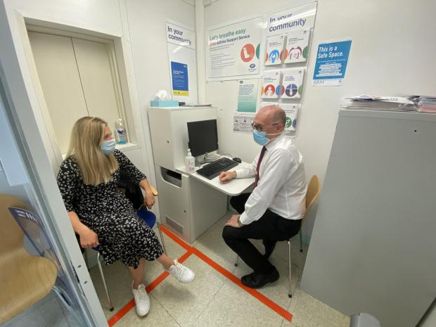 Lancashire Telegraph: A woman preparing for her vaccination at Boots