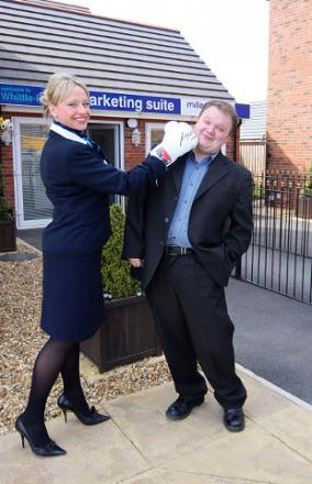 HITMAN: Kirsty Hamilton-Jones from Miller Homes gives a hand to Brian Hann of Buckshaw Residents' Association