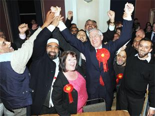CELEBRATION: A delighted Jack Straw celebrates with Labour supporters after he increased his majority