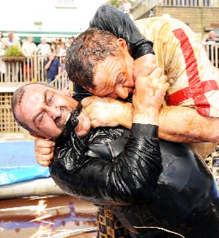 PUSHING BOAT OUT: Andrew Holt, of Waterfoot, battles with Rose and Bowl chef Jon Lowe in last year's gravy wrestling championships
