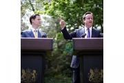 Prime Minister David Cameron (right) and Deputy Prime Minister Nick Clegg hold their first joint press conference in the Downing Street garden