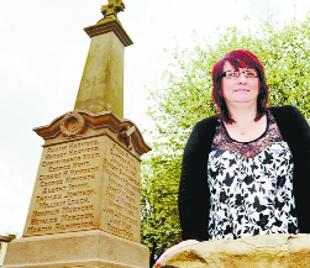 FUNDING PLEA: Coun Julie Slater with the war memorial which she says is in urgent need of repairs
