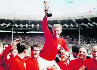 Lancashire Telegraph: Bobby Moore is carried by team members including Geoff Hurst, left