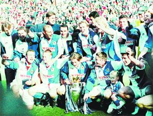 WE ARE THE CHAMPIONS: Rovers players celebrate winning the Premier League title at Anfield in 1995