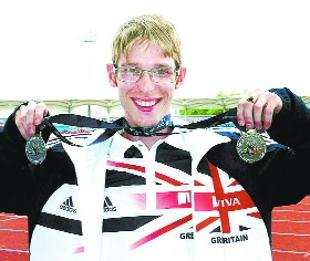 DOUBLE JOY: Graeme Ballard with his medals. Picture: Brian Derbyshire