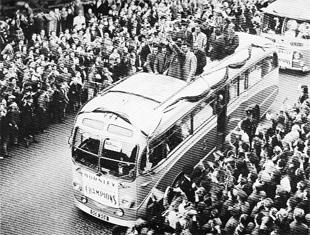 BRING HOME THE CHAMPIONS: Burnley's triumphant 1960 squad enjoy the open-top bus parade in the town