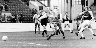 SCOTS PRIDE: Former Burnley captain Tommy Hutchison in action against Millwall