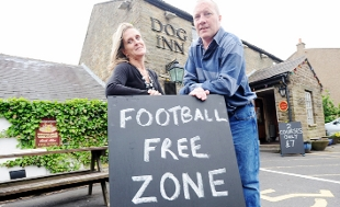 NO FOOTIE HERE: Christine and Brian Hodgkiss with the Football Free Zone