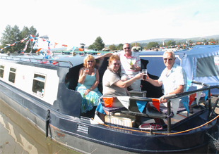 MEMORIES: Flashback to a previous Pendle Canal Festival at Reedley Marina with Margaret Warwick, Pam Barritt, Glyn Barritt and Irwin Warwick, all from Pendle, enjoying the event.