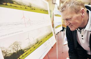 TURBINE DESIGNS UNVEILED: Resident Jack Simpson takes a look at the proposed site of Pendle's first commercial wind farm
