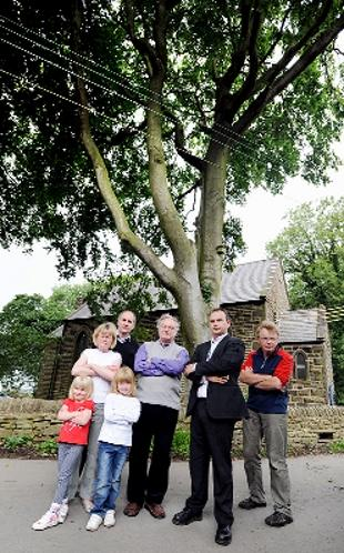 PROTEST: Catherine Rigby, and daughters with resident Andrew Rosthorn, Rev Terence Young, tree preservation officer Russell Critchley, and resident Adrian Rigby