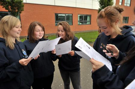 Students from St Wilfrid's, Blackburn celebrate receiving their GCSE grades.