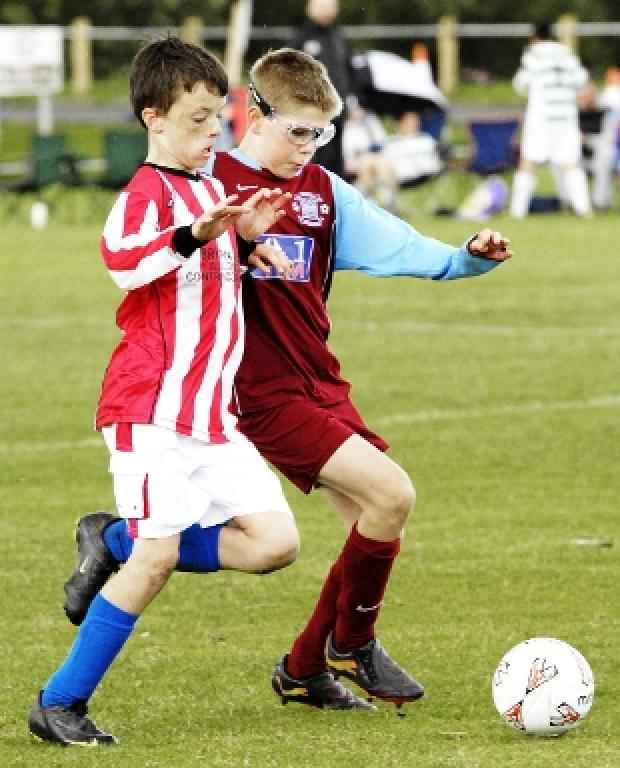 EYES DOWN: Blackburn Eagles U12s and Leyland Albion U12s players tussle for the ball
