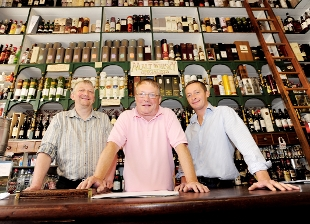 CHEERS FROM US! From the left, Phillip, Andrew and Tim Byrne, of D Byrne and Co in Clitheroe