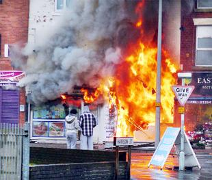 INFERNO: The Almera Polish Shop on fire yesterday morning   Picture by reader Paul Riley