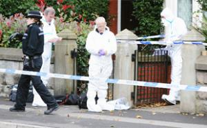 SCENE: Forensic officers leave the house in Limefield Court, Blackburn