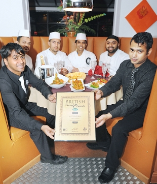 TRIUMPHANT: Staff at Usha celebrate becoming a finalist for the North West Region in the British Curry Awards. From left, manager Foyas Ahmed, Sojib Uddin, Halim Uddin, chef Elaman Ali, chef Ibrahim Ali and managing director Alkas Ali
