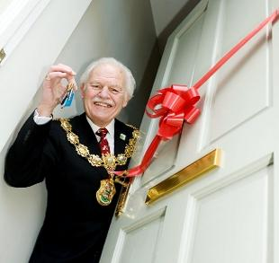 KEYS TO THE DOOR: Above, Pendle mayor Coun Tony Beckett officially opened the new homes in Stanley Street