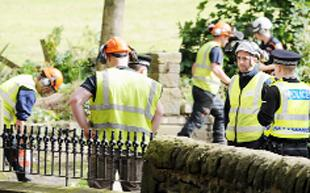 FLASHBACK: Police talk with tree surgeons at the scene