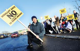 MAKING A POINT: Nick Walker, front, protests with other residents close to the Co-op store in Whalley