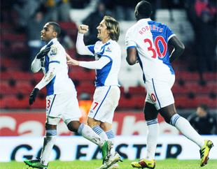 BUILDING FOR THE FUTURE: Rovers defender Michel Salgado, seen celebrating Blackburn's goalscorer Junior Hoilett in the FA Cup third round against QPR on Saturday,
