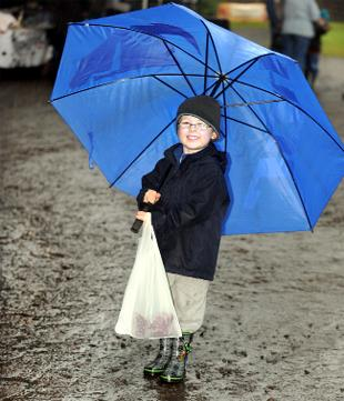 Bailey Douglas, four, from Blackburn, braves the mud at Hoghton Tower Farmers' Market yesterday, which went ahead
