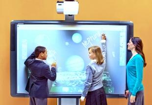 Lancashire Telegraph: FINGERTIP CONTROL: Two pupils demonstrate  accessing the internet on the ActiveBoard 500 interactive whiteboard at Bett 2011