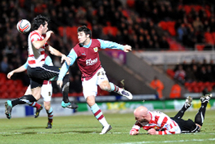 DEBUT BOY New Clarets signing Charlie Austin competes for a cross in the box