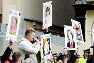 PROTESTS EDL activists with their placards featuring the faces of road accident victims