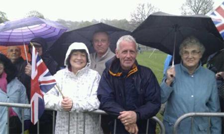 Crowds braving the weather at Witton Park ahead of the royal visit.
