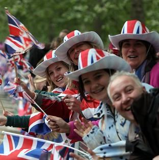 Well-wishers wait for the royal couple in central London