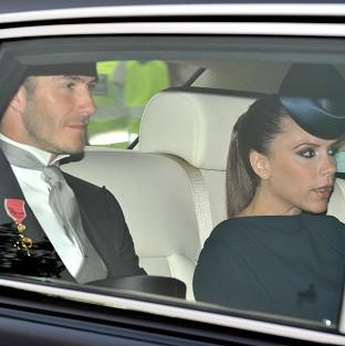 David Beckham arrives at Westminster Abbey with Victoria, who chose to wear one of her own designs to the royal wedding
