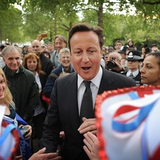 Prime Minister David Cameron meets well-wishers on The Mall
