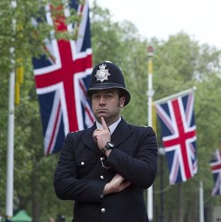 A policeman stands guard on The Mall (AP)