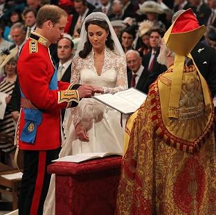 Prince William and Kate Middleton at the altar (PA)