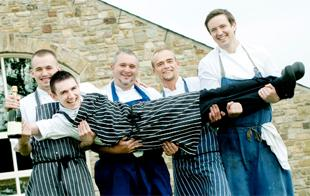 RISING STAR Lewis is held aloft by colleagues at Stanley House Hotel. From left, David Price, John Riding, Lucas Jakubowski, and Andrew Parker