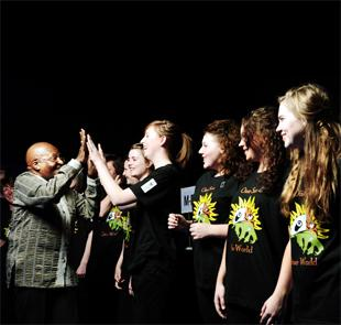 HIGH FIVES Archbishop Desmond Tutu congratulates St Augustine's RC High School pupils