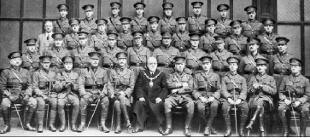 PREPARING FOR WAR Officers of the Accrington Pals in the Drill Hall, Accrington in  1915. With them, front row, centre, is the then Mayor, John Harwood