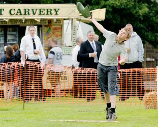 SUMMER TRADITION: Welly throwing champion James Barlow, 14, tosses his final boot during the competition