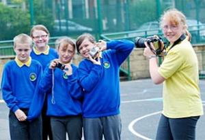 SAY CHEESE Leia Atkin framing her pals at the school, from the left, Jordan Armitage, Elizabeth Livesey, Jennifer Taylor and Katie Hargreaves