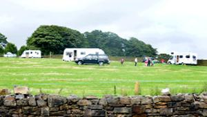 ENCAMPMENT Travellers' vehicles at the farm in Cliviger