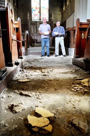 DISASTER Church warden Bernard Parfitt and Coun Richard Newmark survey the damage