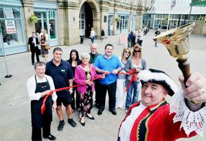 HEAR YE Darwen Town Crier Anthony Meleady, along with the Mayor of Blackburn with Darwen, Coun Karimeh Foster, and traders at the opening of the new shops
