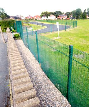 DIVIDED The fence around the car park and playing fields at Helmshore Primary