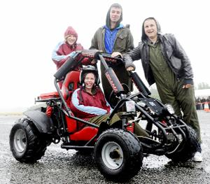 ALL SMILES Becky Bradshaw, Nathan Heys, Luke Sullivan with Stephanie Rickwood on the buggy