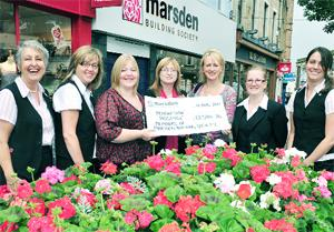 PENNY WISE Marsden staff hand over a cheque for £13,584. From left: Trish Rockcliffe, Elaine Brown, Kaye Bartle, from the hospice, Judith Blackledte, Christine Cope, Rebecca Bolton and Sarah Hasty