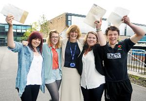 GOOD RESULT Nelson and Colne College principal Lyn Surgeon with students Hannah Petty, Briony Taylor, Georgina Webster and Tommy Allen