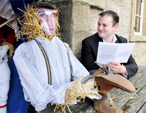 VILLAGE ALIVE! Pendle MP Andrew Stephenson, one of the judges, with the cobbler scarecrow at Four Alls Inn.