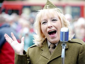 FORCES' SWEETHEART Linda Dee as Vera Lynn serenades the crowd in Darwen's Market Square