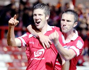 CAPTAIN MARVELLOUS Accrington Stanley skipper Andy Procter celebrates his last minute winner with Kevin McIntrye
